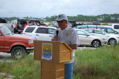 FLORIDA STATE SURGEON GENERAL Dr. John Armstrong addressed the gathering of more than 40 health care officials, local dignitaries and first responders at Grayton Beach State Park on Tuesday, Aug. 18. The Health in All Places event was sponsored by the Florida Department of Health.