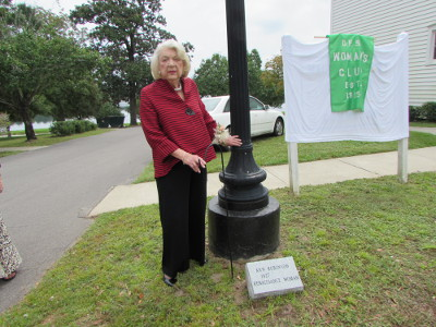 ANN ROBINSON stands next to her newly unveiled plaque. Robinson was honored by the DeFuniak Springs Woman's Club as a Woman of Light on Sept. 11.