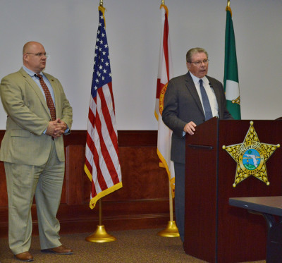 STATE ATTORNEY Bill Eddins (right) and Walton County Sheriff Mike Adkinson at the Sept. 24 press conference on the released report by the grand jury that was impaneled to investigate alleged miscalculations made in the Planning Department.  (Photo by Dotty Nist)