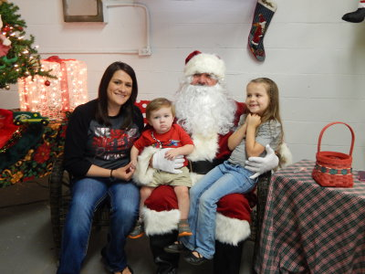 YOU ARE NEVER TOO OLD or too young to tell Santa what you want for Christmas. The Walton County Fair Grounds saw huge crowds on Nov. 28 as the traditional Hometown Christmas event filled the fair building with vendors, craftsmen, volunteers, shoppers and even Santa Claus.