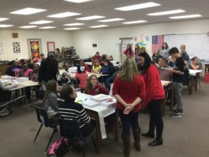 """PARENTS AND STUDENTS participated in small groups addressing a variety of math-related applications. Walton Middle School's families showed their commitment to their children's education by attending the school's second Title 1 Parent Training Night of the year.The event, """"Making Math Matter,"""" occurred on Dec. 3 at 6 p.m."""