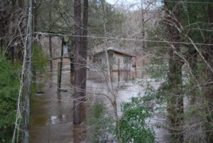 THE OLD HIDE-A-WHILE CAMPGROUND and lodge was inundated by last week's flood. The campground has been closed for some time but this is a good example of the extent of the flooding. As of Tuesday, Jan 5, the river was slowly receding. (Photo by Jeffrey Powell)