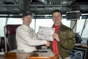 BRIAN S. ASSELSTINE, Petty Officer 3rd Class (l) was named Warrior of the Day Jan. aboard the U.S.S. Harry S. Truman (CVN 75), where he currently serves.  Asselstine, of DeFuniak Springs, Fla., has served in the Navy for three years as a personnel specialist. He is a 1999 Walton High School graduate.