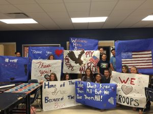 AVID MEMBERS pose with their patriotic signs for the Vietnam Veterans' Honor Flight.The AVID (Advancement Via Individual Determination) Program at Walton High School is completing its fourth year at Walton High School. Throughout the year, AVID classes participate in a diverse selection of activities which prepare students to be outstanding citizens and successful adults in selectedcareer paths. (Photo by Teresa Bogart)