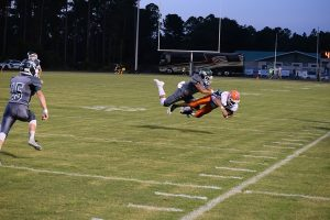A SOUTH WALTON AND A COTTONDALE player had a mid-air collision during a play in the first half of the Seahawks fifth consecutive win against the Hornets this past Friday night. The Seahawks host Blountstown in their district opener on Friday at 7 p.m. (Photo by Jeffrey Powell)